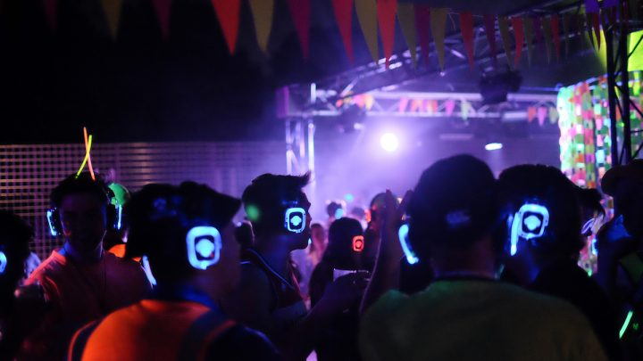 students dancing at the silent disco with colourful headphones on